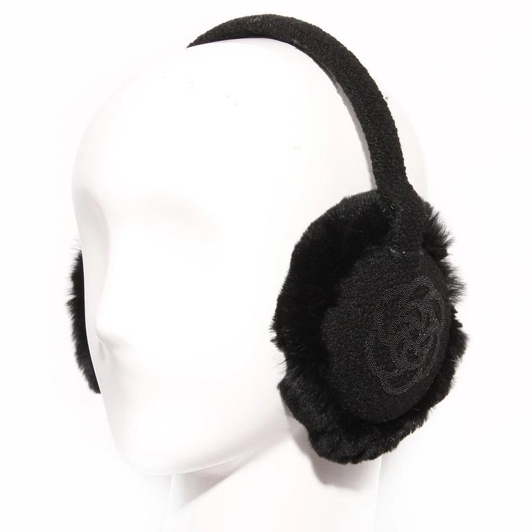 Chanel by Karl Lagerfeld Earmuffs Earmuffs covered in black bouclé Circular ear pieces Each ear piece has a sparkling black beaded camelia Interior of ear piece is covered in soft black rabbit fur  Left side of headband has black interlocked CC