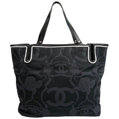 CHANEL Camellia And CC Embossed Canvas Tote Bag
