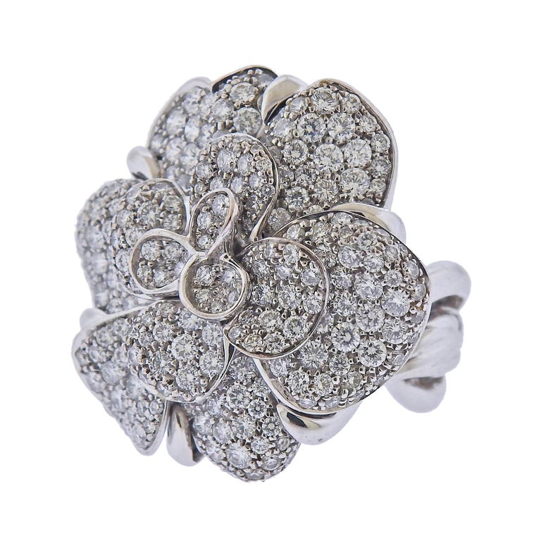 18k white gold large Camellia ring by Chanel, with approx. 3.20ctw in VVS1/E diamonds. Retail $36500. Measurements - Ring size - 5.25, ring top - 30mm x 28mm. Marked - Chanel, 750, 50, French marks, 6R5338. Weight 25.1 grams.