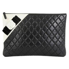 Chanel Camellia O Case Clutch Quilted Lambskin Large