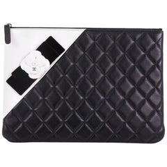 Chanel Camellia O Case Clutch Quilted Lambskin Medium