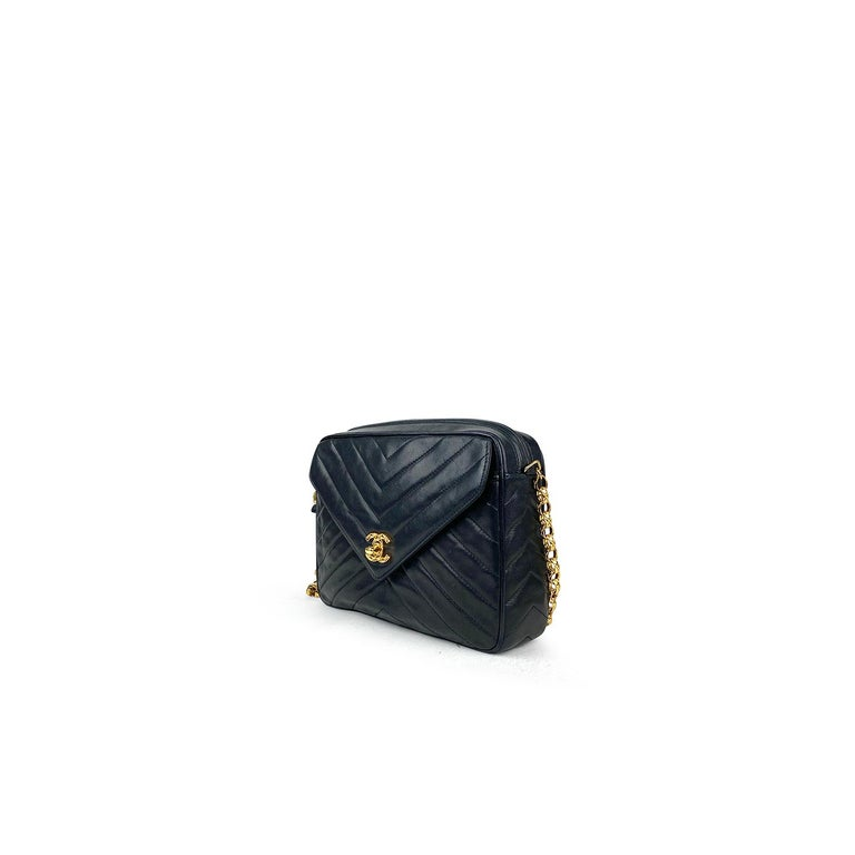 Black leather Chanel Camera crossbody bag with  - Gold-tone hardware - Single chain-link shoulder strap - Single exterior pocket at front featuring CC turn-lock closure - Tonal leather lining, dual pockets at interior walls; one with zip closure and
