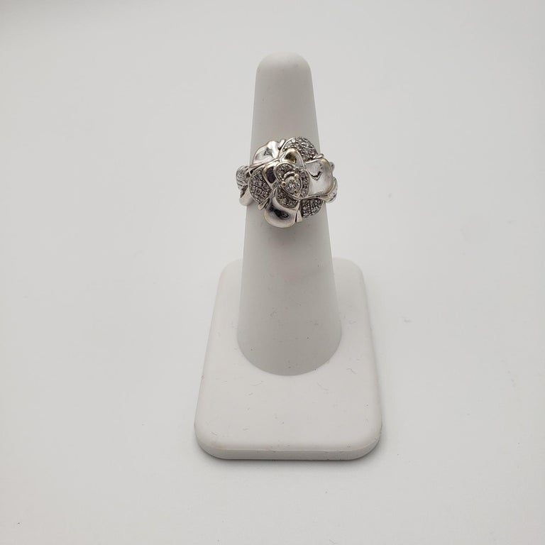 Authentic Chanel 'Camillia' flower ring crafted in 18 karat white gold and set with an estimated 0.40 carats of round brilliant cut diamonds. Signed Chanel, 91, 872, 750. Ring size 5 3/4. Not presented with original box or papers. CIRCA 2010s.