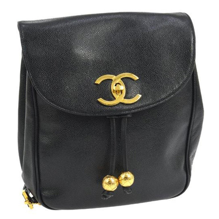 Chanel Black Caviar Backpack Vintage 2 Pocket Ball Charm CC Logo  Chanel Black Caviar Backpack with golden ball charms.  This chic vintage Chanel backpack is ideal for everyday style about town. From 1990's.  Straps measure 30