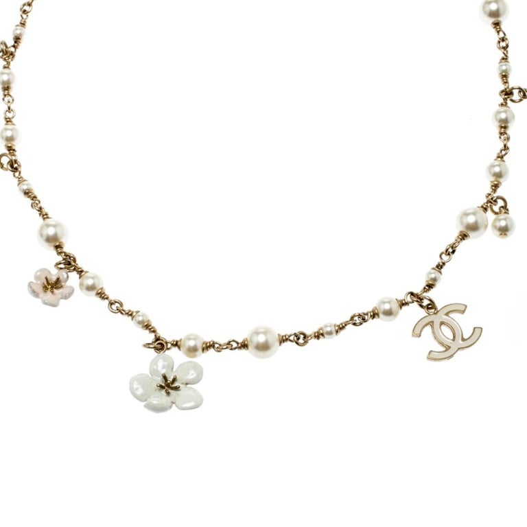 The Chanel headband creates a look for you that you can easily call your crowning glory. It brings a stretch fabric panel and gold-tone metal chain with charms of Camellia, faux pearls and CC logos, making the band comparable to a tiara.  Includes: