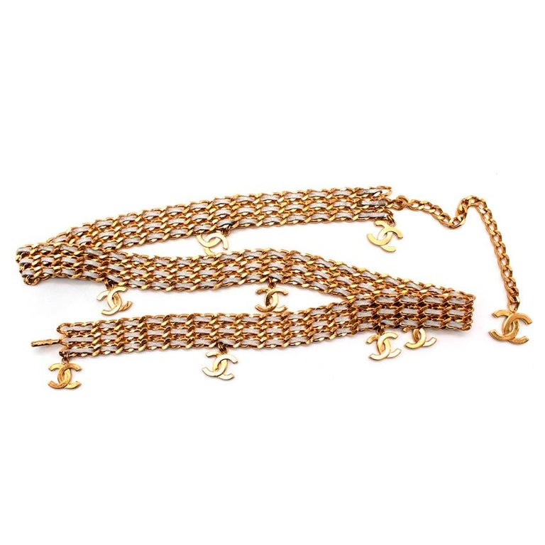 Chanel CC Drop Gold Tone Chain & Silver Leather Woven Belt  - Spring 1997 Collection - silver leather signature woven style belt with gold tone metal chains - Gold tone CC embellishments attached onto the belt - Hook fastening with adjustable