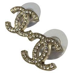 CHANEL CC Earrings in Pale Gilded Metal