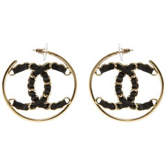 Chanel CC Gold tone black leather earrings