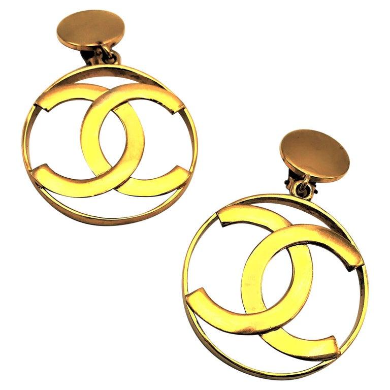 Chanel CC Logos sunburst hoop dangle ear clips gold plated For Sale