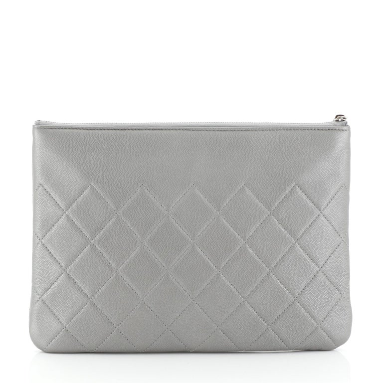 Chanel CC O Case Clutch Quilted Caviar Medium In Good Condition In New York, NY