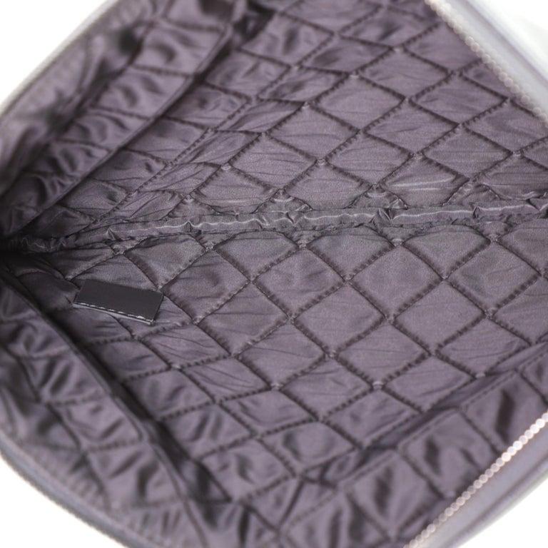 Chanel CC O Case Clutch Quilted Caviar Medium 1
