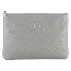 Chanel CC O Case Clutch Quilted Caviar Medium