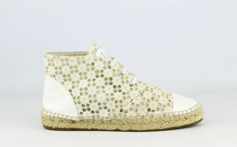 Chanel's lace-up espadrilles in ecru crochet, featuring the brand's trademark interlocking CC logo on the tongue in a ecru patent leather, they have a thick jute sole and a reinforced toe which offers a comfortable and supportive fit.  Sole measures