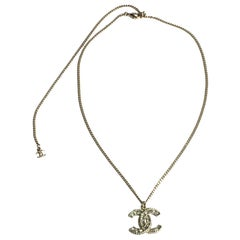 CHANEL CC Pendant Necklace in Gilt Metal and Strass