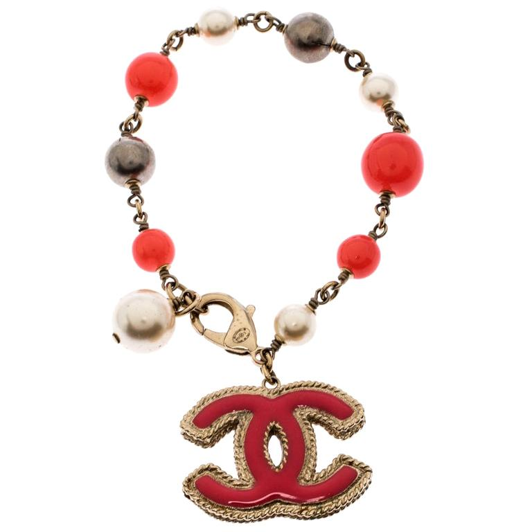 Chanel CC Pink Enamel Faux Pearl Bead Gold Tone Charm Bracelet For Sale