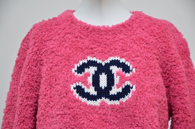 100% authentic Chanel guaranteed. Chanel teddy sweater in pink tone  Due to flashlight color tone might vary in person. New with tags.Original receipt with personal info covered is available to purchaser upon request Size 40FR. Please familiarize