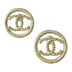 CHANEL CC Stud Earrings in Gilt Metal