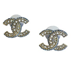 CHANEL CC Stud Earrings in Matte Gilded Metal and White and Sky Blue Rhinestones