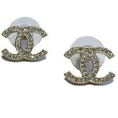 CHANEL CC Stud Earrings in Pale Gilded Metal set with Rhinestones