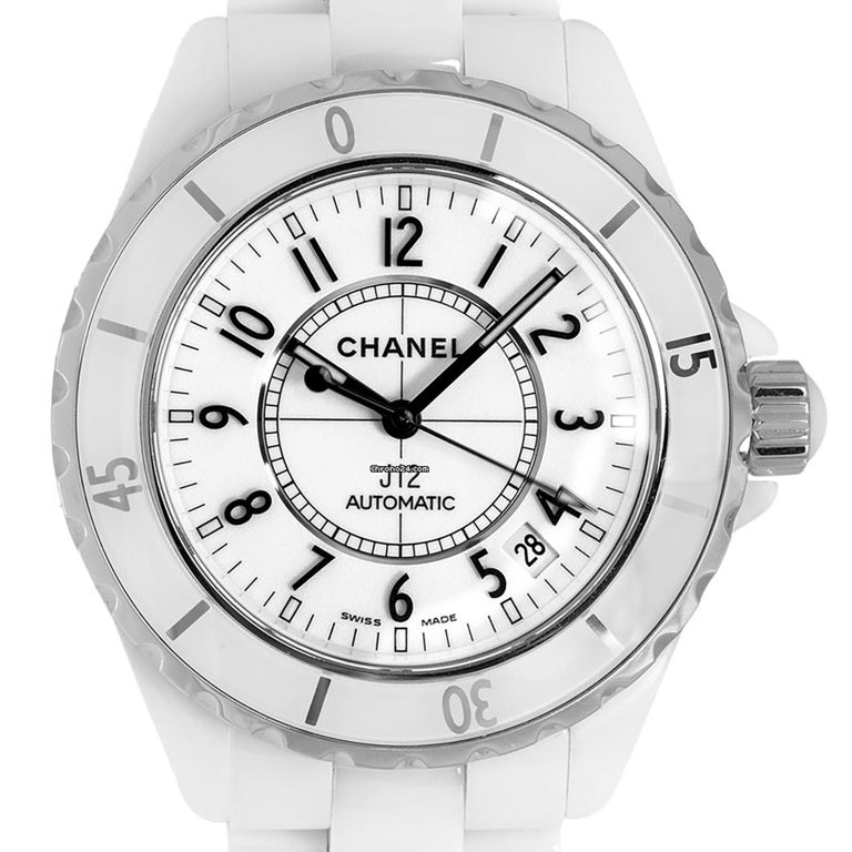 Chanel J12 ceramic and stainless steel case with a ceramic bracelet. Fixed bezel. White dial with white hands and stainless steel index - Arabic numerals hour markers. Dial Type: Analog. Date display between 4 o'clock and 5 o'clock position.