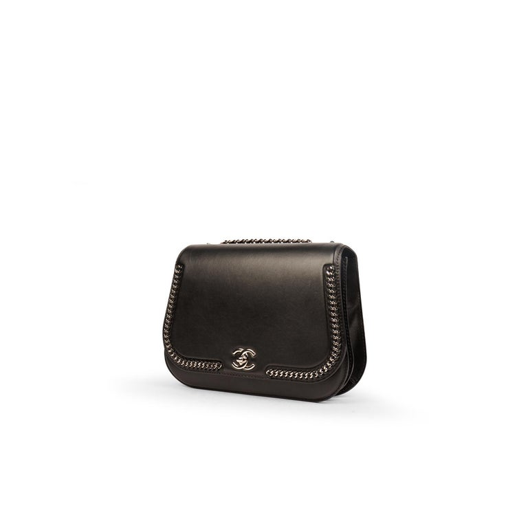 Black leather Chanel Chain Around Medium Flap bag with   - Silver-tone hardware - Convertible chain-link shoulder strap - Chain-link trim at exterior - Black interior lining - Dual interior pockets one with a zip pocket at interior wall and CC