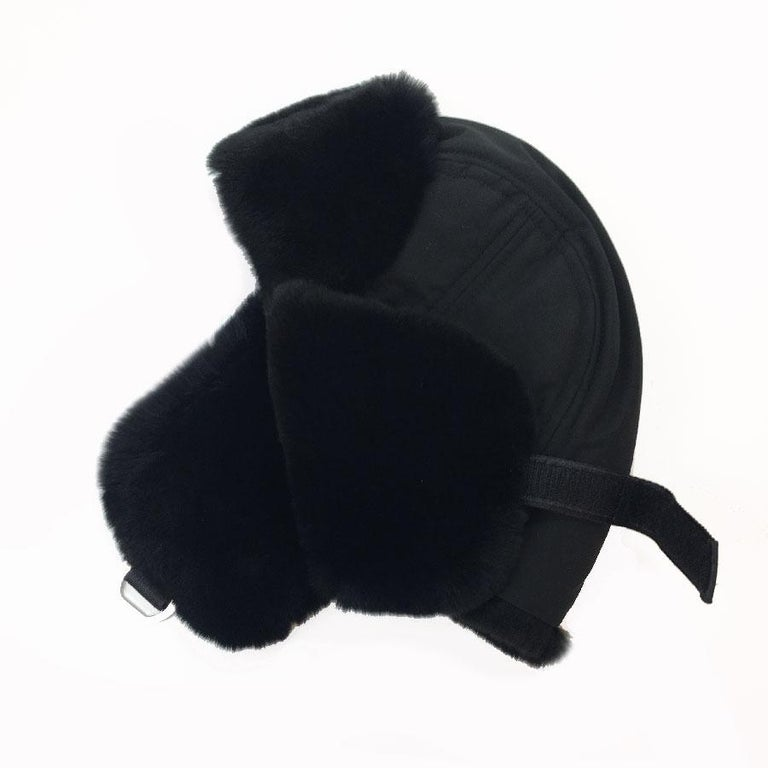 Very beautiful Chanel hat, chapka style. Black orylag headband and Teflon style fabric top.  Immaculate condition.  Dimensions: head circumference: 58 cm, length of the earmuff: 17 cm  Will be delivered in a new, non-original dust bag