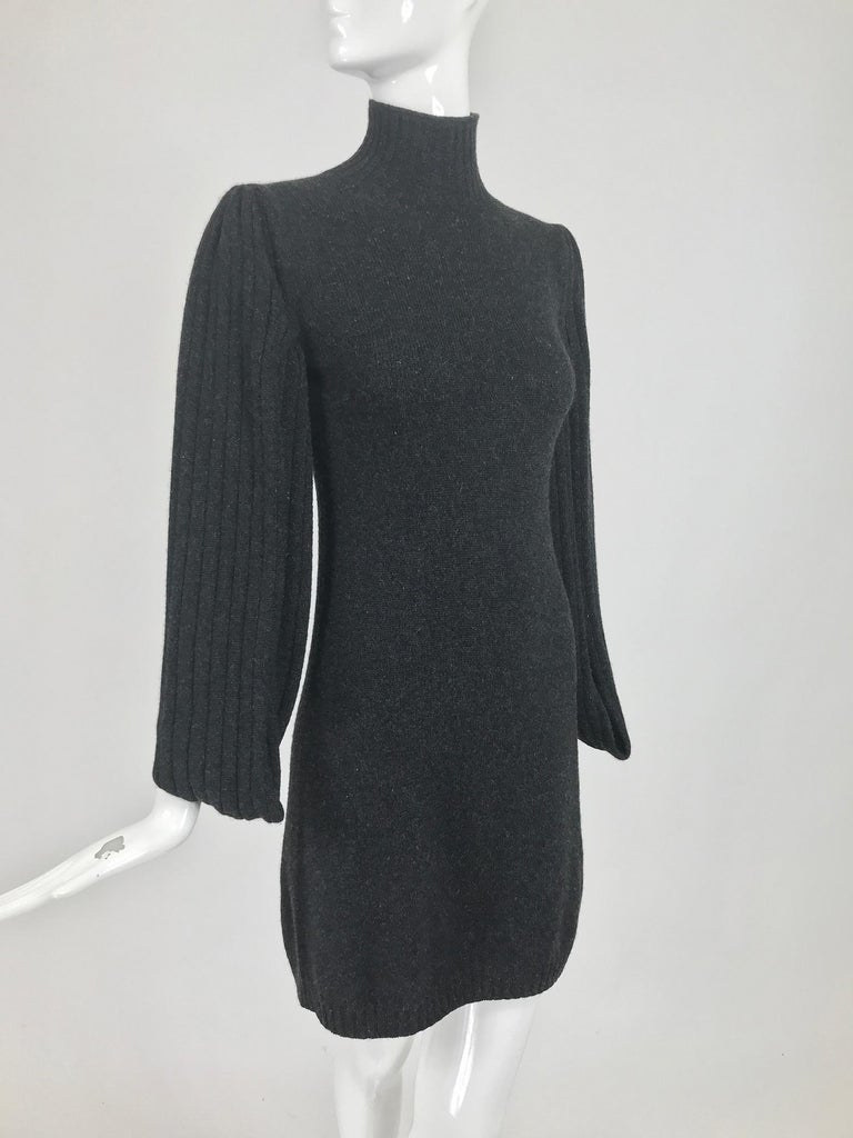 Chanel charcoal grey cashmere cage sleeve dress 2007a. This gorgeous dress is so soft, with the most unusual sleeves, they are open at the front and and back from cuff to under arm, they have v openings at the cuff for your hands. The sleeves are