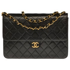 Chanel Classic 25cm shoulder bag in black quilted lambskin and gold hardware
