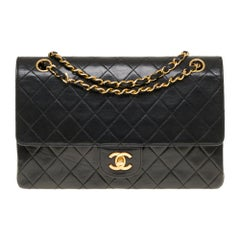 Chanel Classic 27cm shoulder bag in black quilted lambskin and gold hardware