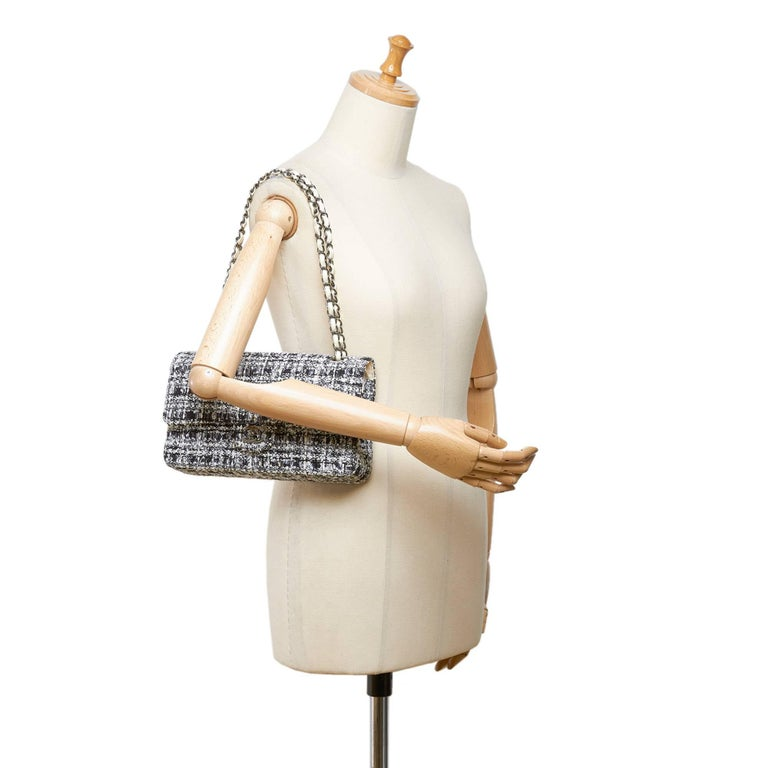 """- Chanel classic black/white/grey cotton tweed medium double flap shoulder bag.   - Featuring exterior back slip pocket, white leather silver-toned chain straps, double front flaps with interlocking """"CC""""  and twist lock closure, and interior slip"""