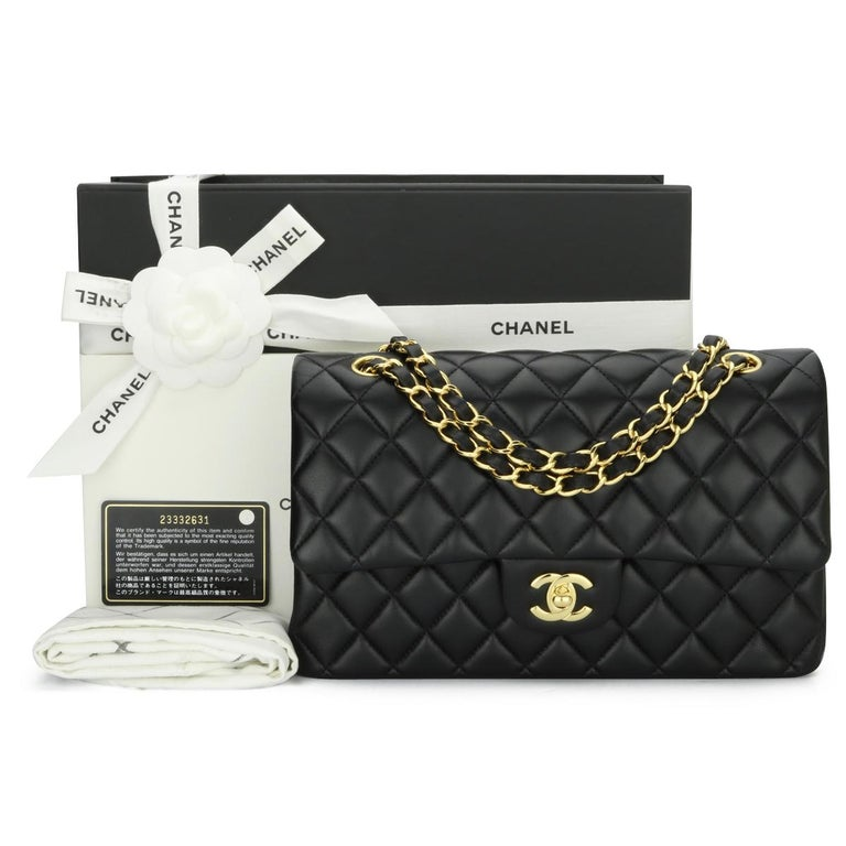Authentic CHANEL Classic Double Flap Bag Medium Black Lambskin with Gold Hardware 2017.  This stunning bag is still in mint-pristine condition, the bag still holds its original shape, and the hardware is very shiny. Leather still smells fresh as if