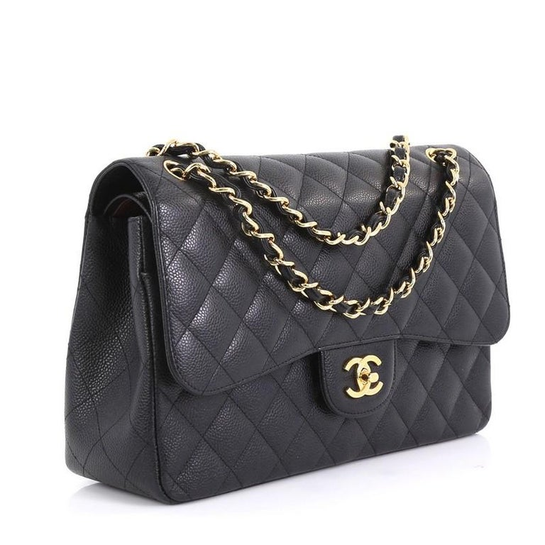 This Chanel Classic Double Flap Bag Quilted Caviar Jumbo, crafted from black quilted caviar leather, features woven-in leather chain strap, exterior back pocket and gold-tone hardware. Its double flap and frontal CC turn-lock closure opens to a red