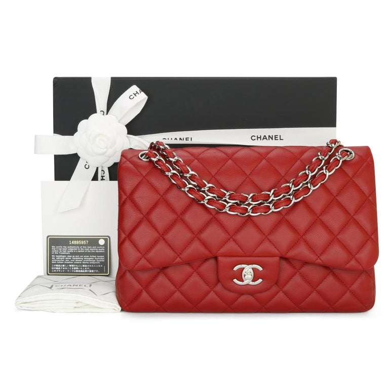 CHANEL Classic Double Flap Jumbo Bag Red in Soft Caviar with Silver Hardware 2011.  This stunning bag is in very good condition, the bag still holds its shape well, and the hardware is still very shiny.  - Exterior Condition: Very good condition,