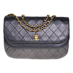 Chanel Classic double Flap shoulder bag in Black quilted lambskin and GHW