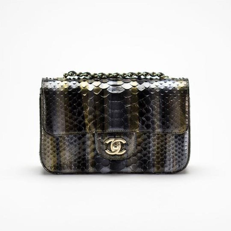 Chanel Ombré Python Exotic Snakeskin Rare Classic Flap  Gold hardware Classic back pocket Classic CC turnlock clasp Interior center zippered pocket Grey interior lambskin lining Additional interior pocket Interwoven python skin chain Strap Drop