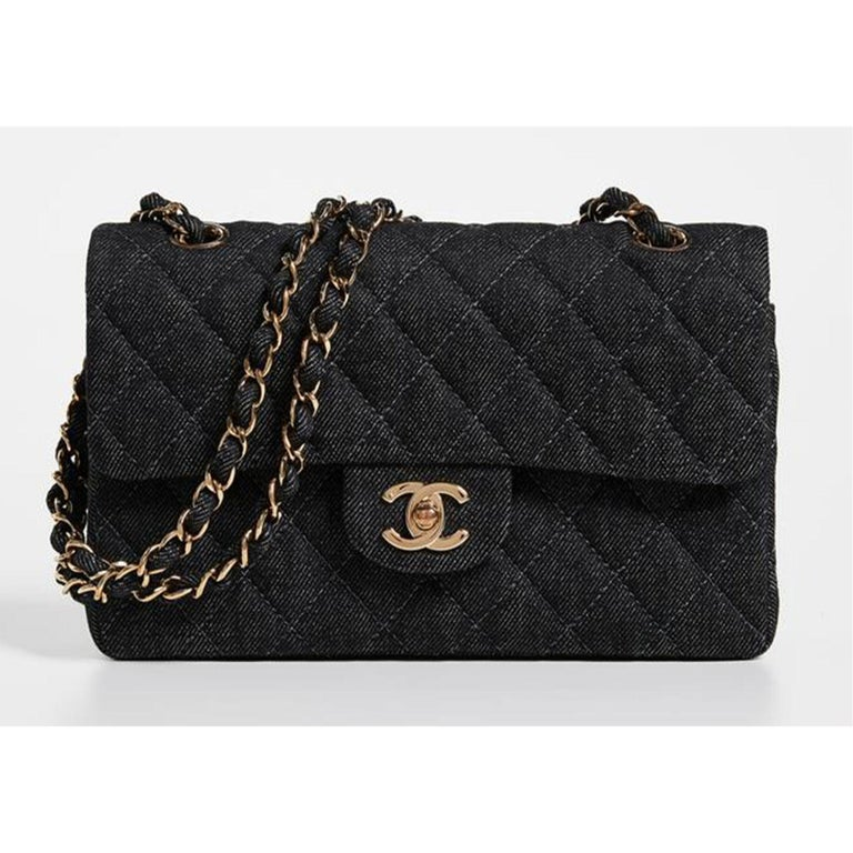Chanel Rare Vintage Small Denim Quilted Classic Flap Bag  1998 {VINTAGE 23 Years} Gold-tone hardware Turn-lock in front Classic back pocket  Lined in black lambskin leather Interior zippered pocket Dust bag included, box available upon request  Made