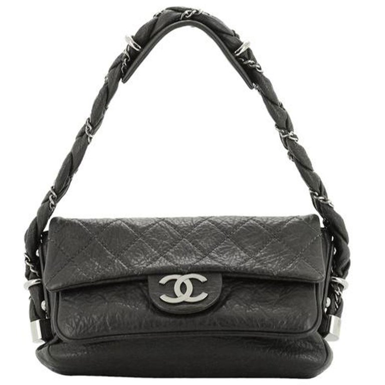 Chanel Lady Braid Quilted Distressed Quilted Lambskin Small Classic Flap Bag  2006 {VINTAGE 15 Years}  Silver hardware Soft diamond quilted distressed lambskin leather Top handle is braided leather with signature interwoven chain  Silver Chanel CC