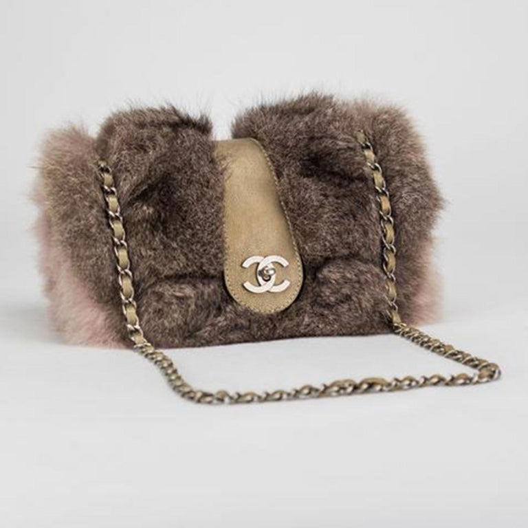 "Pink brown Chanel fur with deerskin interior lining and aged silver hardware  2005 {VINTAGE 16 Years}  Interwoven chain  Interior center zipper pocket  Strap drop: Single 16"" Double 9""  6"" H x 10"" W x 4"" D  Made in Italy"