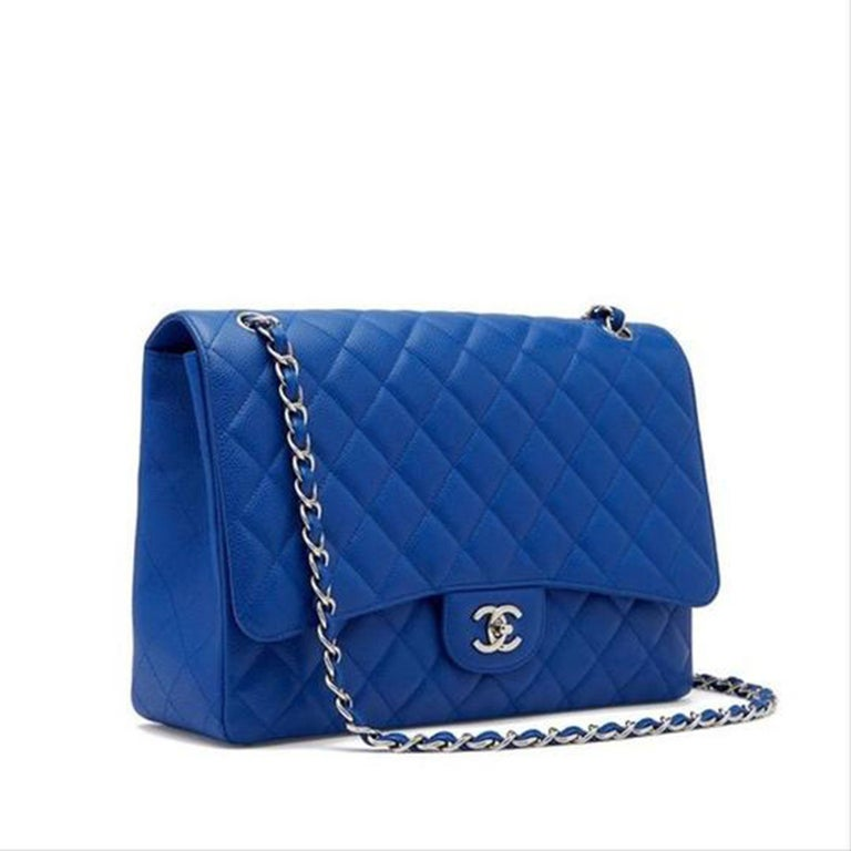 Chanel Rare Limited Edition Caviar Blue Roi Maxi Classic Flap Bag  Year: 2009 {VINTAGE 12 Years} Silver hardware Diamond quilted caviar leather Classic interwoven chain strip CC turn-lock closure Strap drop: 9