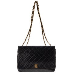 Chanel Classic handbag in navy quilted lambskin leather, golden metal hardware!