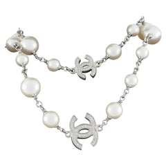 Chanel Classic Long Pearl Necklace with 5 CC Silver Crystal Logos