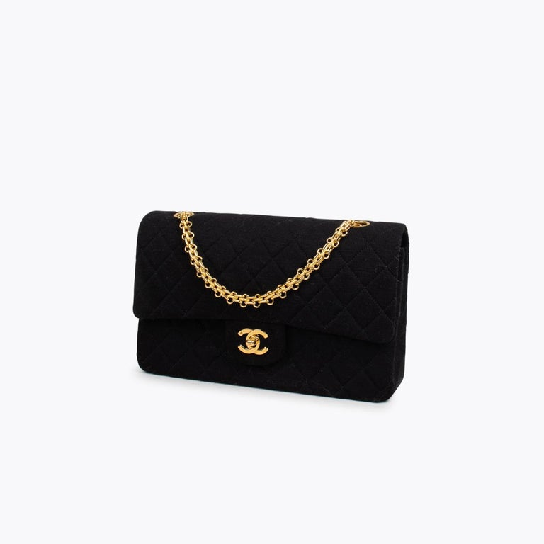 Black Chanel Classic Medium Jersey Double Flap Bag  – Gold-tone hardware – Interlocking CC logo & quilted pattern – Chain-link shoulder straps – Single exterior pocket – Burgundy leather lining & dual interior pockets and turn-lock closure at
