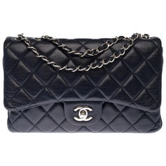 Chanel Classic Shoulder bag in navy blue quilted leather and silver hardware