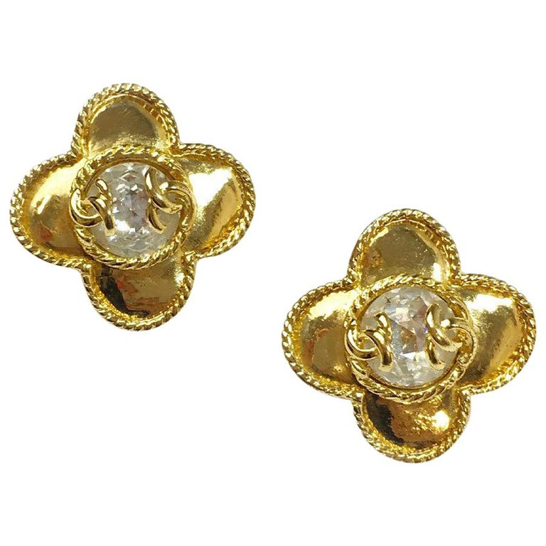 CHANEL Clip-on Earrings in Gilt Metal set with a Large Rhinestone and CC For Sale