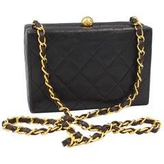 Chanel clutch shoulder bag in black leather
