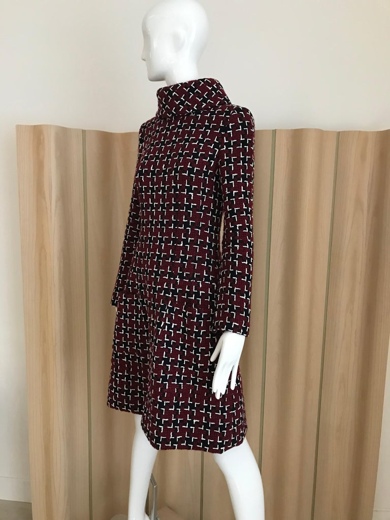 Chanel long sleeve dress with Interesting pattern of tweed in burgundy, white and black dress with mock neck and pockets. Dress is lined in silk. New With Tag Marked size: 34 Measurement: BUST: 32 inch/ WAIST: 28inch / HIP: 36 inch/ LENGTH: 37