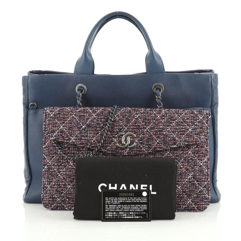 This Chanel Coco Break Shopping Tote Caviar with Tweed Large, crafted from blue caviar leather, features dual rolled leather handles, woven in leather chain straps, front flap pocket, and aged silver-tone hardware. It opens to a red leather interior
