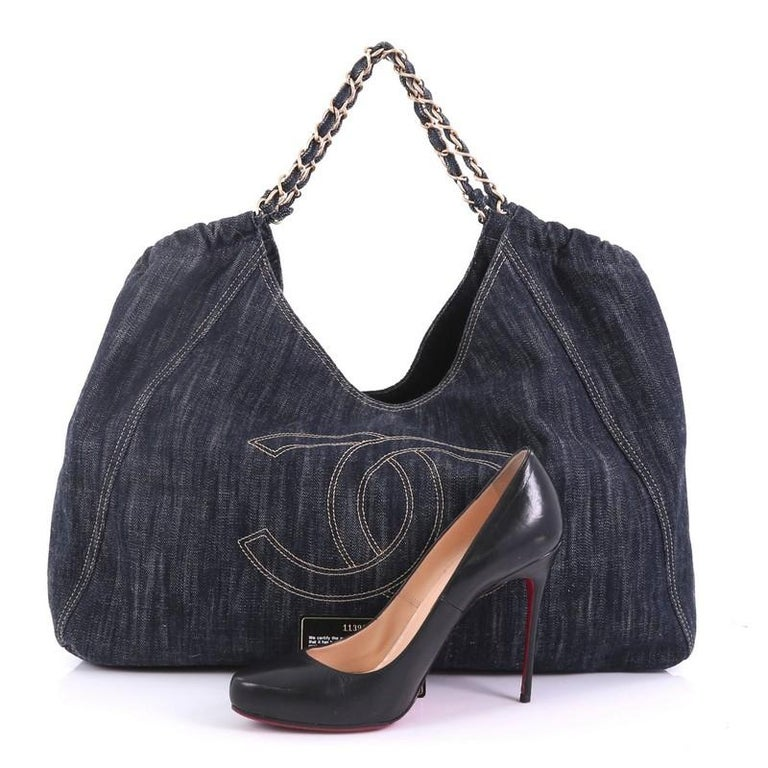 8852b257ff6f0a This Chanel Coco Cabas Denim Large, crafted in blue denim, features an  oversized stitched