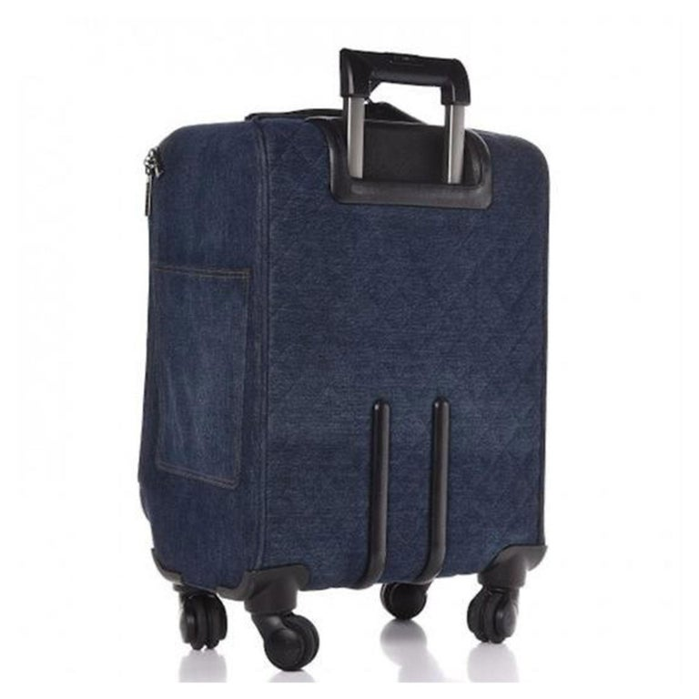 Chanel Coco Cuba Trolley Travel Luggage Rolling Carry On Denim Cuba Suitcase  Chanel Cruise 2017 Dark wash blue denim Silver-tone hardware Retractable handle dual flat handles at top and side Wheels at base black Caviar leather trim Printed woven