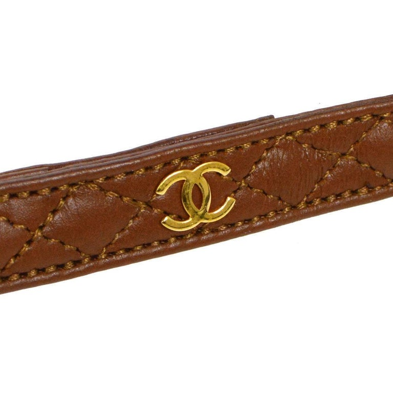 Chanel Cognac Leather Gold Charm Walking Pet Leash  Leather Gold tone hardware Hook closure Made in France Width 0.50